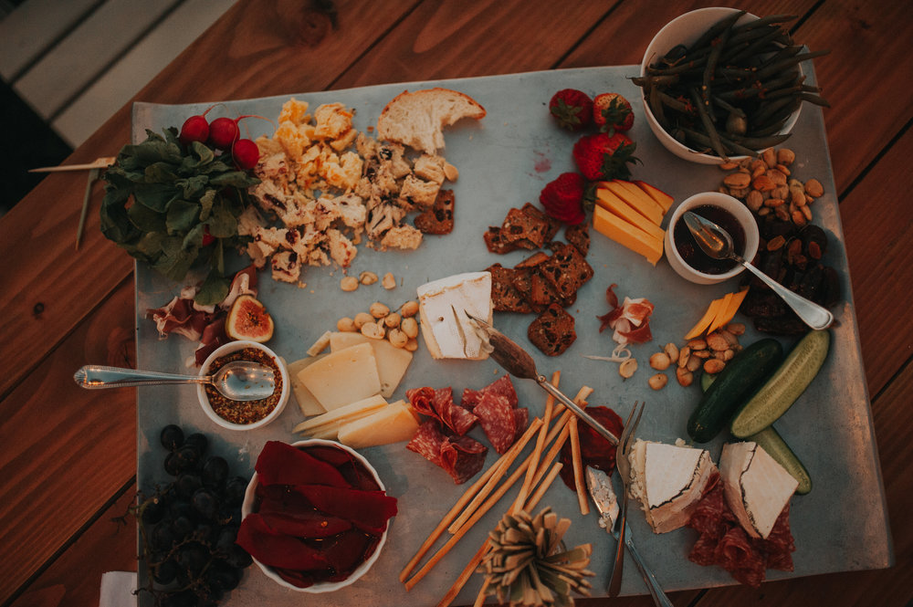 charcuterie board filled with all kinds of cheeses and meats on a wedding table in the Temecula Valley.