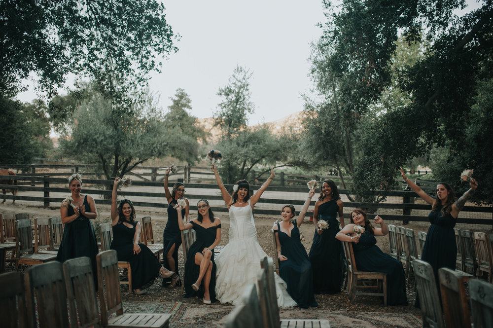 Bride wearing Zac Posen with her brides maids sitting in vintage chairs from Birdie in a Barn a vintage rental company in the Temecula Valley.