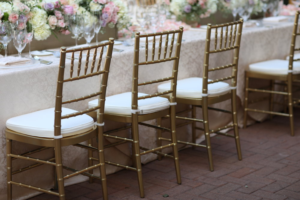 Gold Chiavari chairs at the wedding table at the Resort at Pelican Hill, in Orange County.