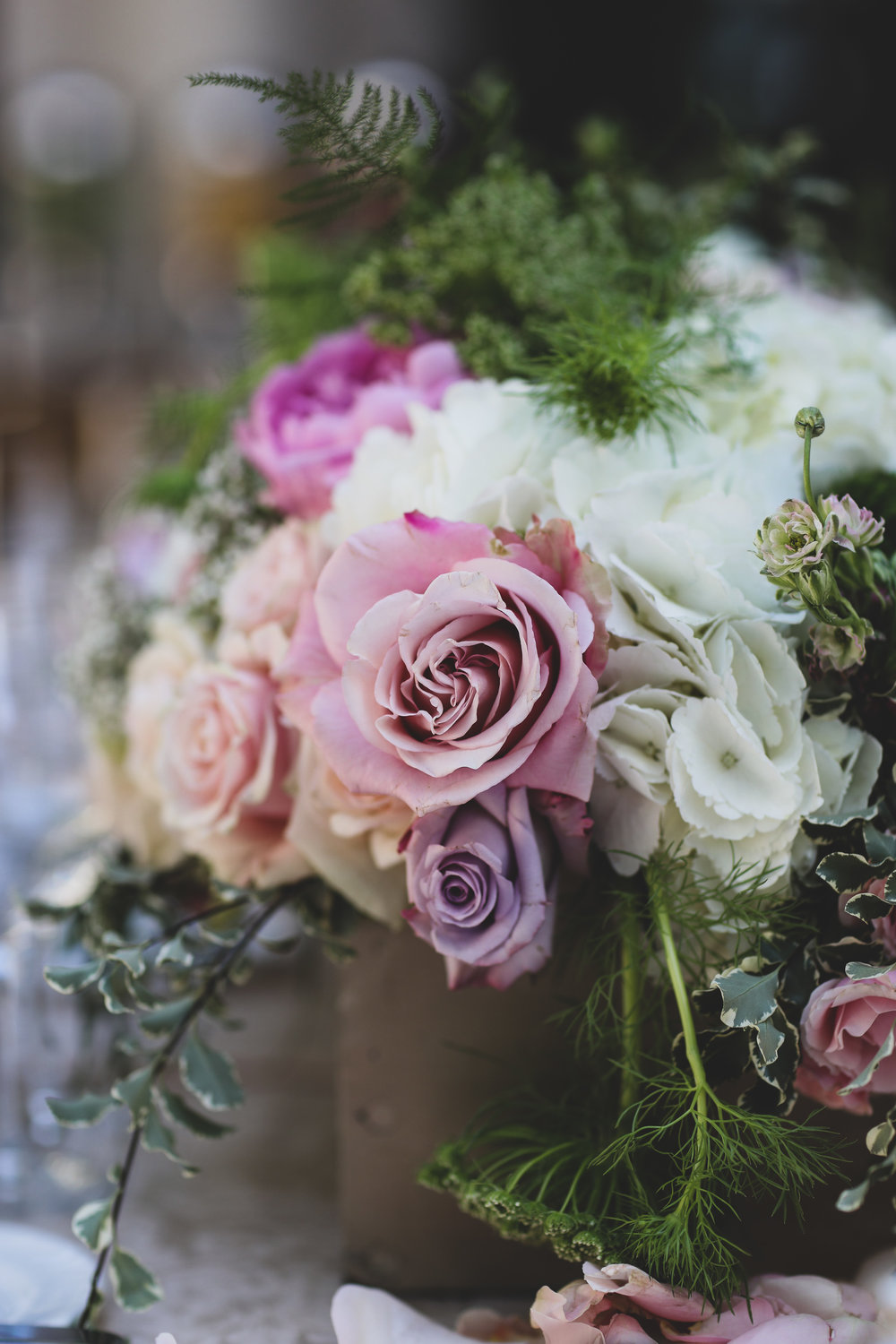 Lavender and pink roses make up this wedding floral arrangement done by Bleudog Floral at the beautiful Pelican Hill in Orange County.