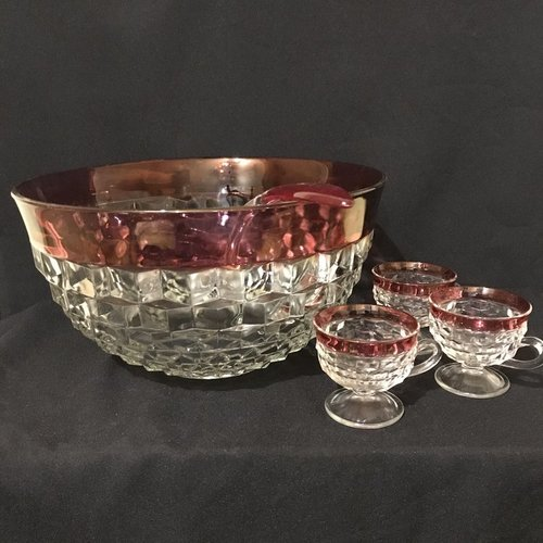 """Ruby Rimmed Punch Bowl.    Cut glass with a ruffled cube pattern with a ruby glass rimmed edge. Ladle and 12 cups. 13.25"""" round x 7"""" tall."""