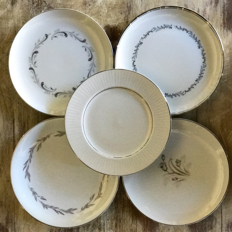 Mismatched China silver bread plates. Wedding rentals in The Temecula Valley.