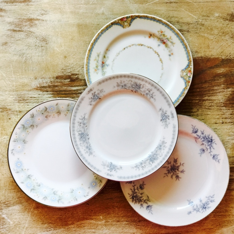 Group of vintage mismatched china. Blue bread or appetizer plate. Rentals in the Temecula Valley.