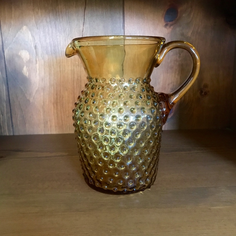 Amber colored glass pitcher with Swiss dots on it. Vintage glass rentals in Murrieta.