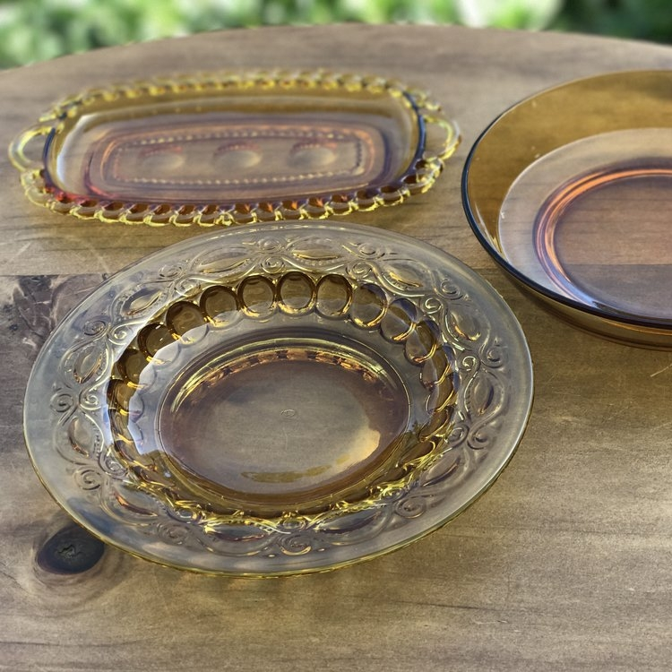 Amber Glass Serving Pieces.    Assorted serving bowls. Perfect pop of color.