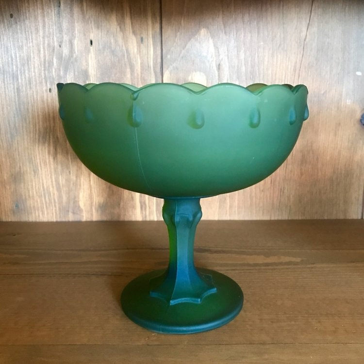 Shorter green glass compote with scalloped edge with teardrops. Wedding rentals in the Temecula Valley.