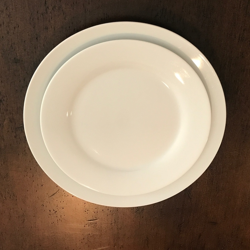White classical dinner and salad plates. Perfect for any wedding, event, or party. Rentals.