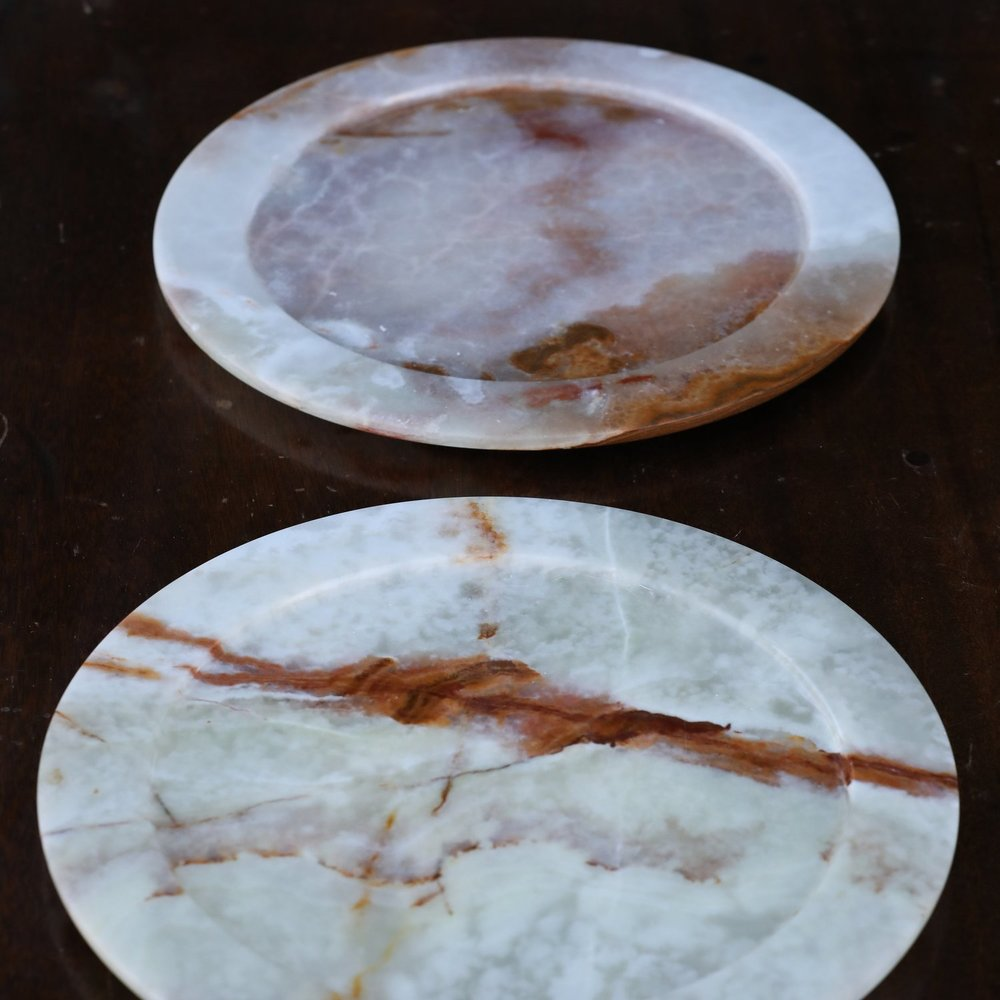 Light marbled granite stone charger plates. Variegated colors because of the natural organic stone. Rentals.