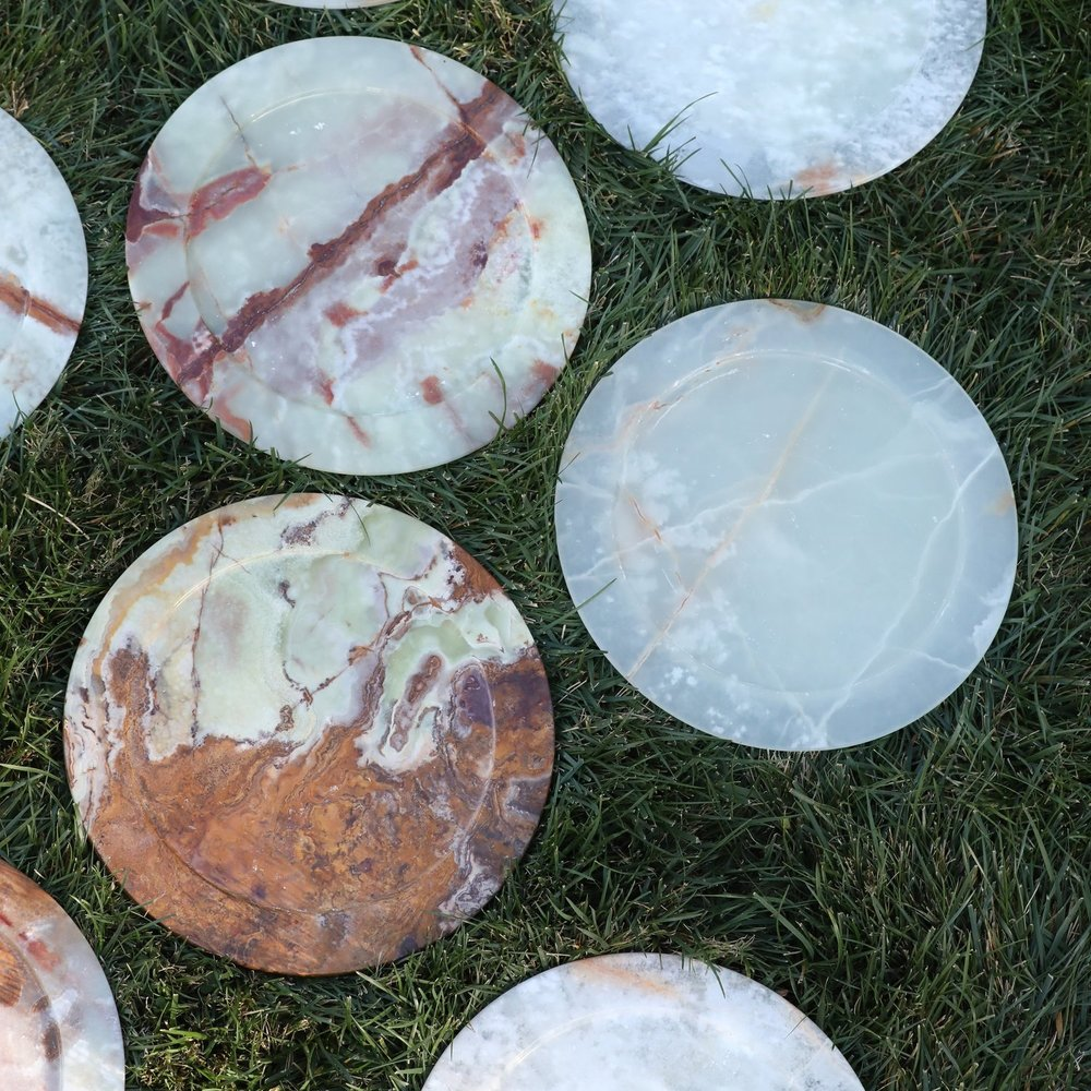 Assorted granite natural organic stone charger plates. Wedding rentals in the Temecula Valley.