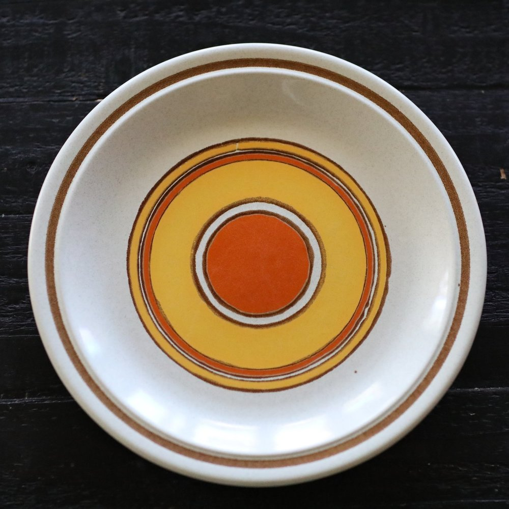 Vintage 1980's stoneware with orange and yellow circles. Mismatched wedding rentals in Murrieta.