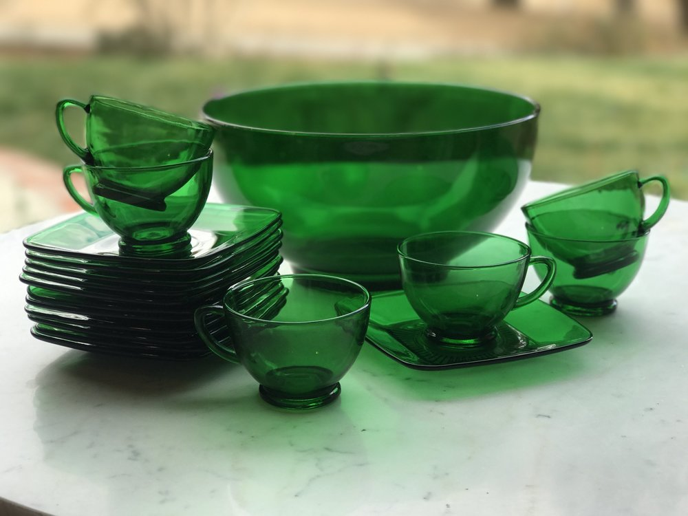 Emerald green Libby Glass punch bowl with cups and square saucers.