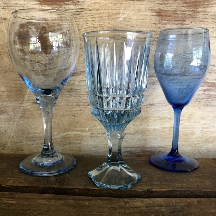 Mismatched vintage colored glass blue goblets. Wedding rentals in the Temecula Valley.