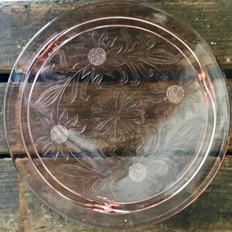 "Daisy Pink Glass Serving Plate    12"" round in diameter with etched daisies on it."