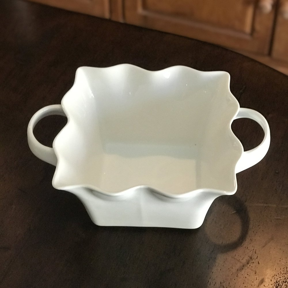 "White Ruffled Edge Bowl.    Two sizes: 10"" x 6"" or 7.5"" x 5"". Two handles."