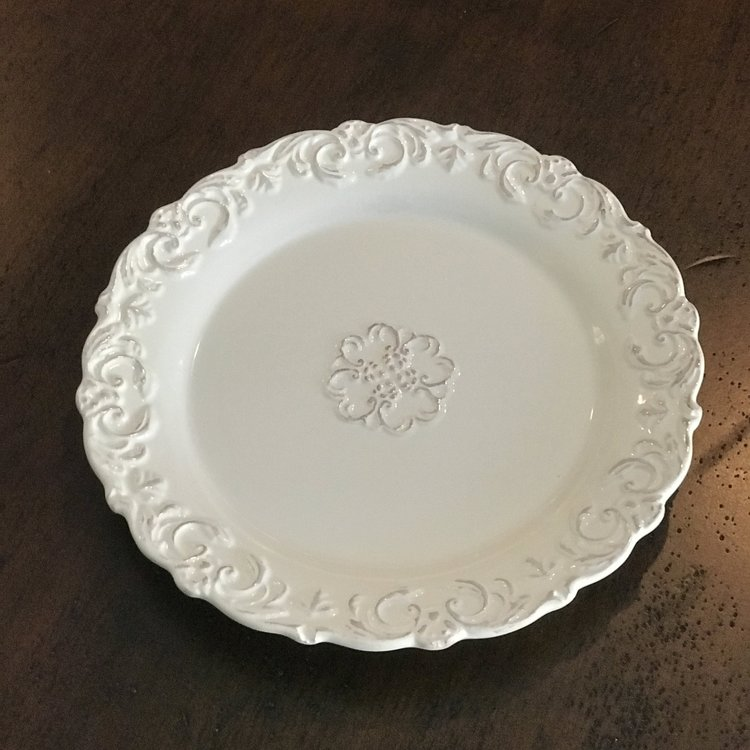"White Patterned Edge Platter    7"" round porcelain platter with patterned scalloped edge."