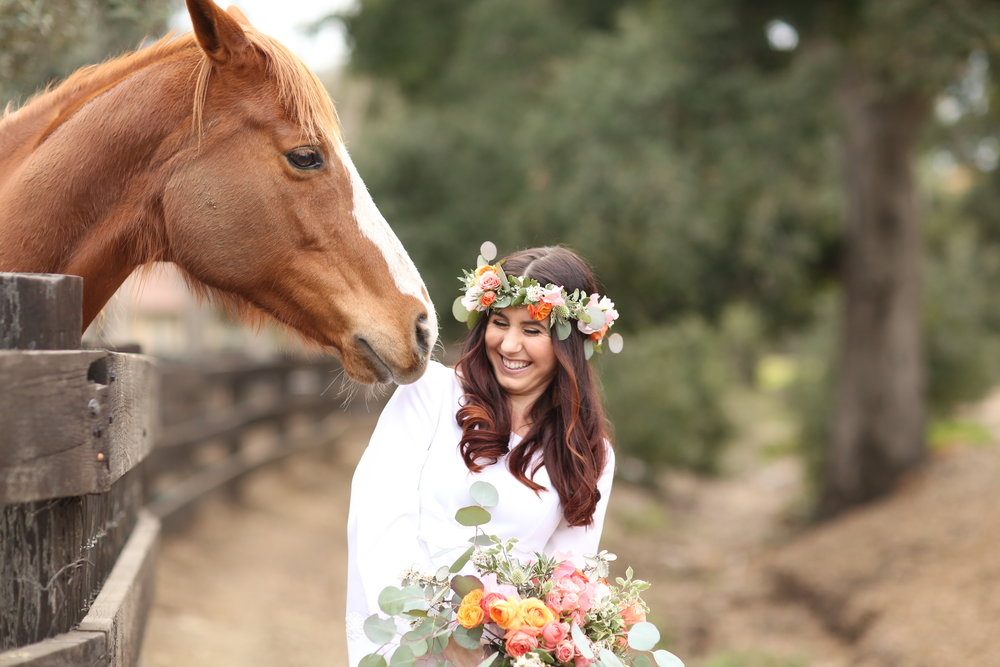 Chateau Adare in Murrieta has horses on the property, This horse thought it would be good to eat the brides flowers.