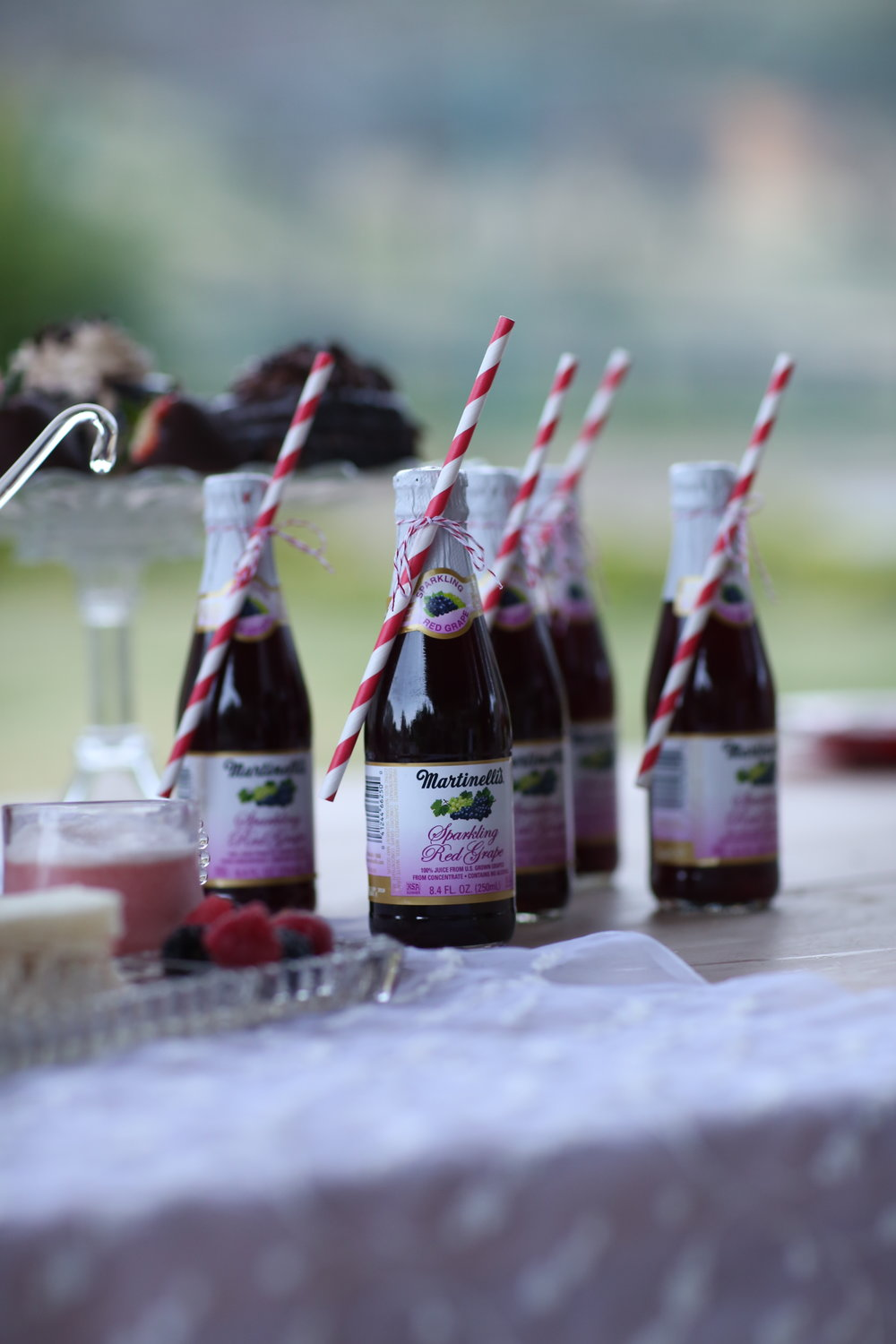 Stripped straws ties on little bottles of Martinelli's at a wedding reception in Murrieta.