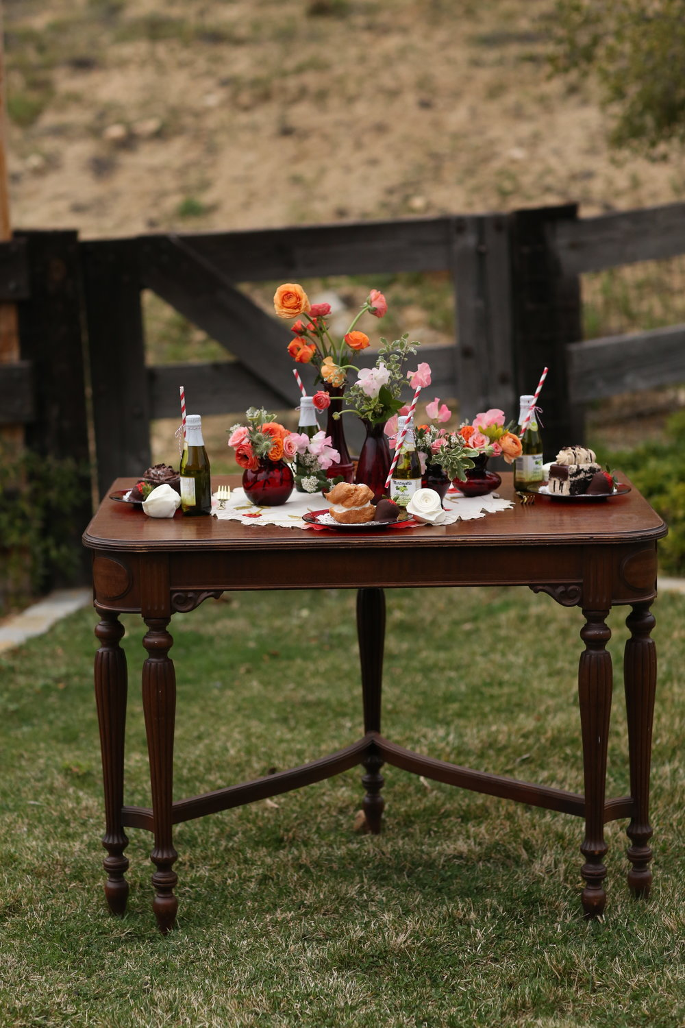 Vintage table with red ruby glass accents. Vintage wedding rentals in the Temecula Valley.
