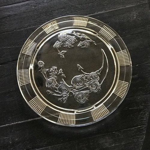"""Rose Cake Platter    Round cake platter on small legs. Rose etchings in the platter. 12"""" round."""