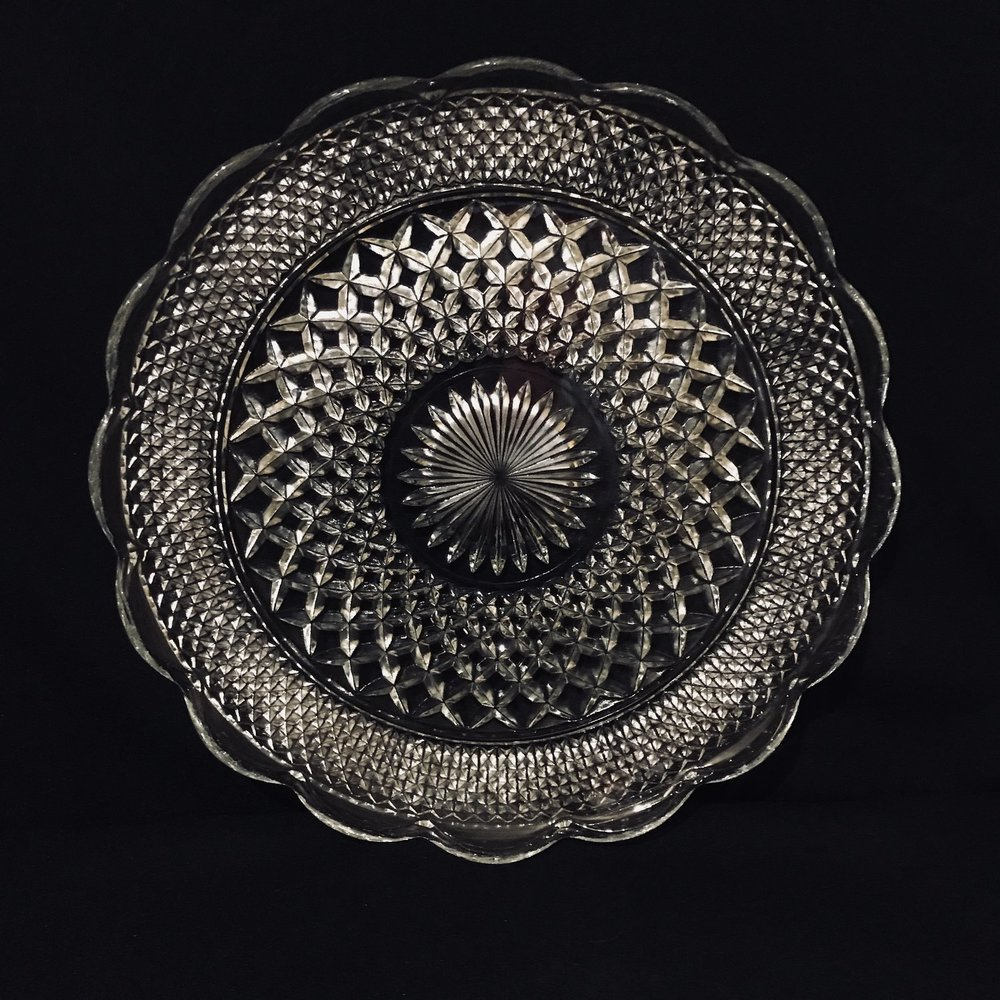 "Diamond Pattern Platter.    Cut glass diamond banded platter with a sunburst center and scalloped edge. True Mid-century Modern. 14"" round."