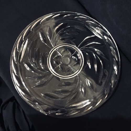 """Swirling Leaf Platter.    Cut glass platter with a swirling leaf pattern. Three small feet. 13.25"""" round."""