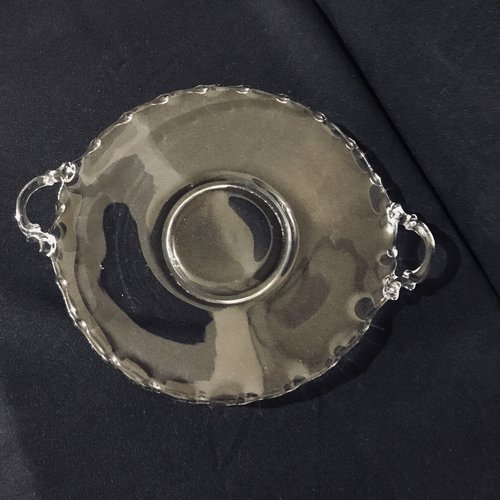 """Teardrop Platter.    Small clear glass platter with a teardrop edge. 9"""" plate, 11.5"""" with handles."""