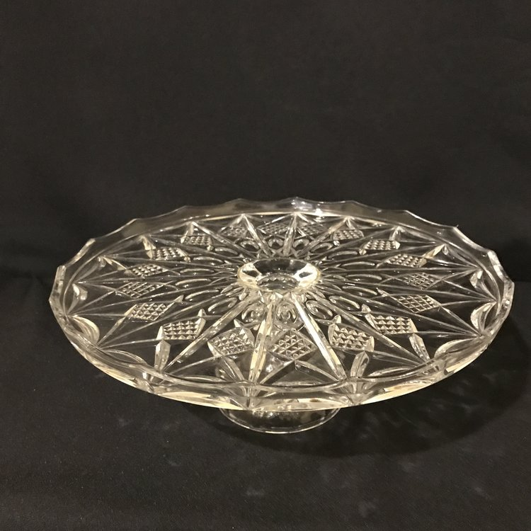 """Pineapple Pedestal Platter.    Beautiful cut glass pedestal plate with a pineapple pattern and a rounded base. The vertical rim on the plate goes up with a slight scallop. 12.5"""" round x 5"""" tall. Great for a cake plate."""