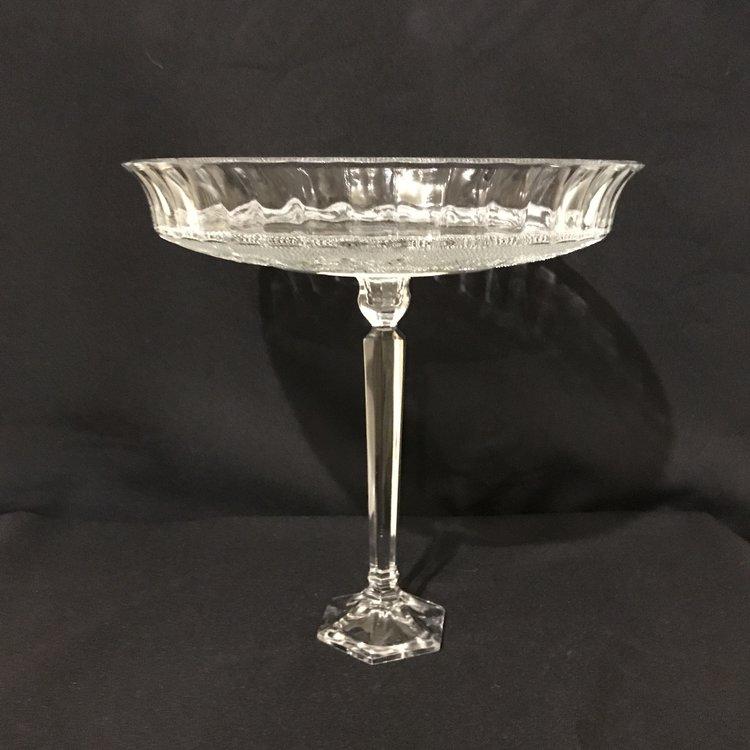 """Fleur de lis Pedestal Platter.    Extra tall cut glass pedestal platter with a Fleur de lis pattern. 1.75"""" upturned edge. 11.75"""" round x 10"""" tall."""