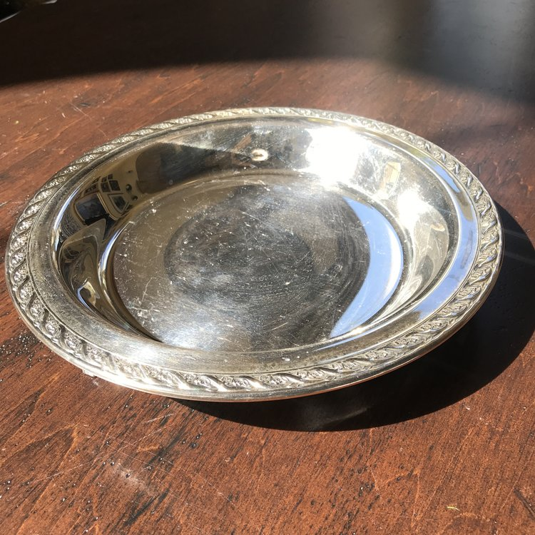 """Round Footed Silver Tray    Vintage silver plate round footed serving tray with decorated edge. 11"""" round."""