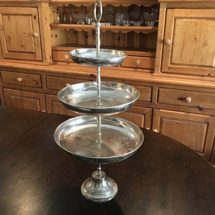 """Silver Three Tiered Tray Fancy    Three tiered fancy silver plated serving tray on decorative pedestal with embossed Boho handle at the top. 21"""" tall. 11.5"""", 11.5"""", and 8"""" trays."""