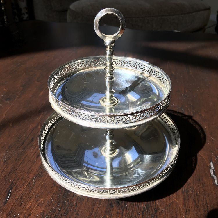 """Silver Two Tiered Tray Fancy.    Vintage silver plated two tiered serving tray with lattice edges and a round handle. 10"""" tall x 7"""" bottom, 5.5"""" top. Cute as a button!"""