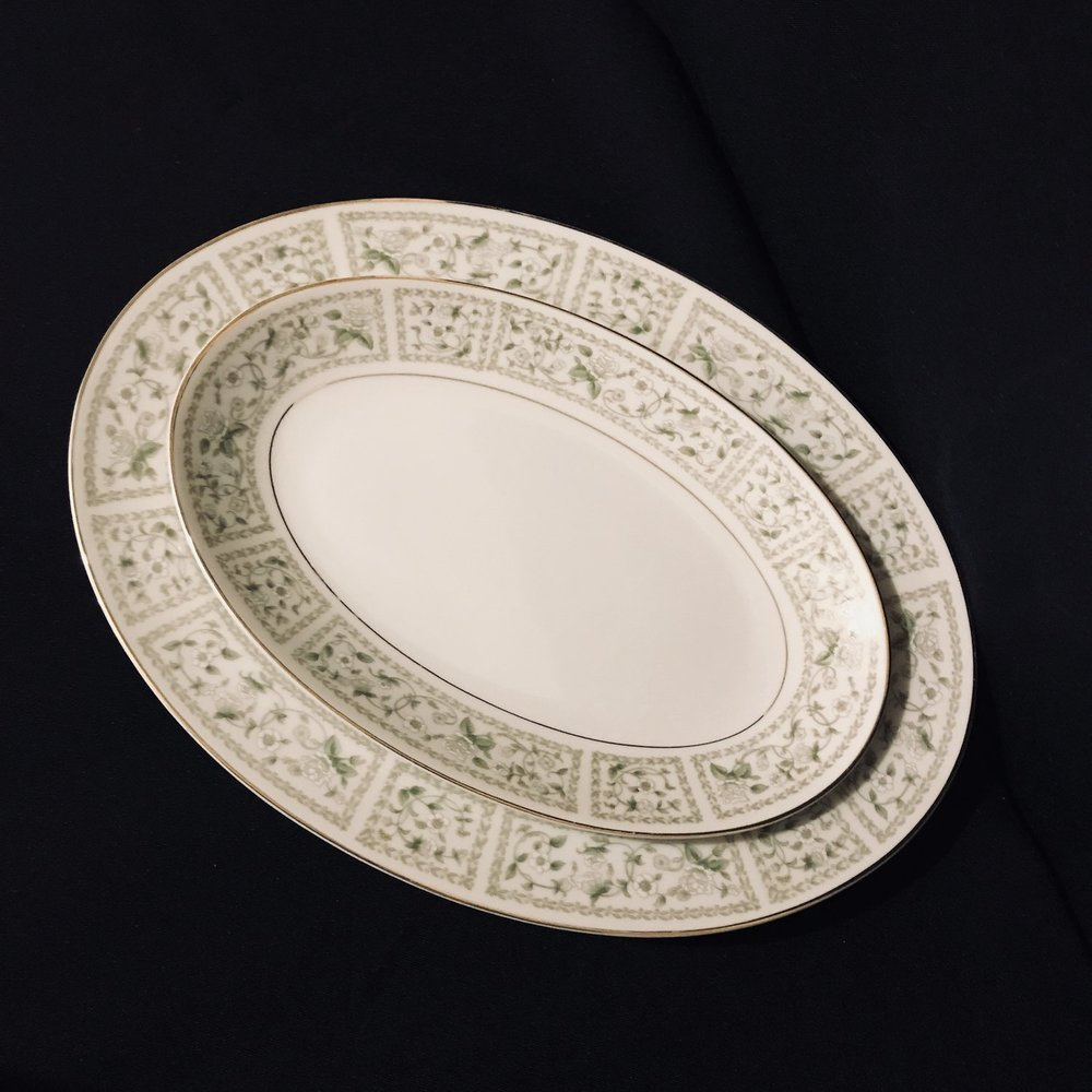 Mismatched vintage china platters with a floral rimmed pattern. Wedding Rentals in Murrieta.