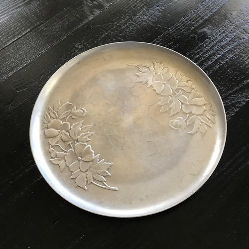 "Aluminum Round Floral Tray.    Embossed with a beautiful floral design this tray is 11.5"" round."