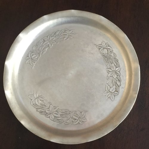 "Aluminum Scalloped Tray.    Mid-century modern aluminum serving tray. Round, Plumeria floral embossed, with scalloped edge. 17"" round."