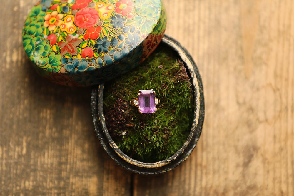 The wedding ring was amethyst and was photographed in a vintage cloisonné box.