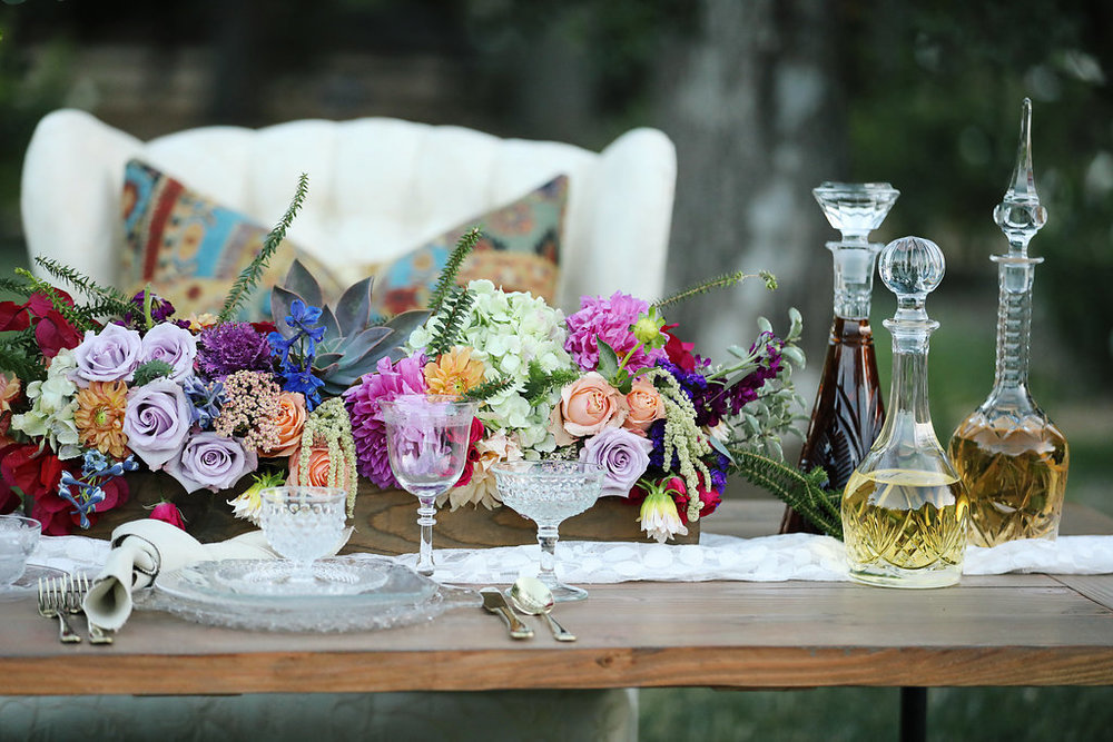 Ultra violet bohemian wedding table with vintage cut glass decanters. Murrieta.