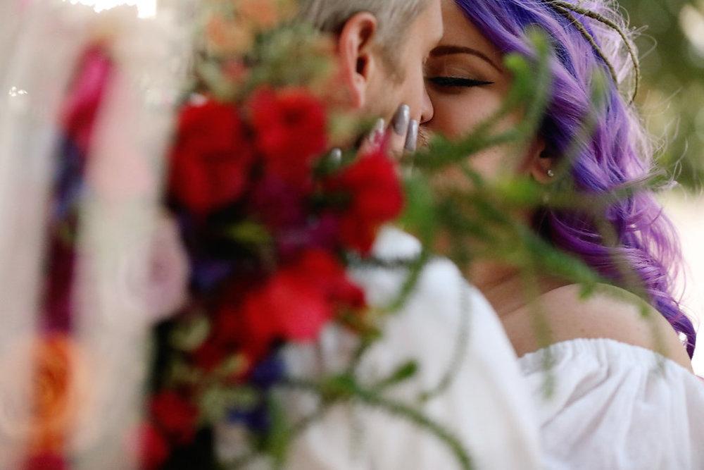 Ultra violet hair bride kisses her groom at Chateau Adare in Murrieta, California. Wedding Venue