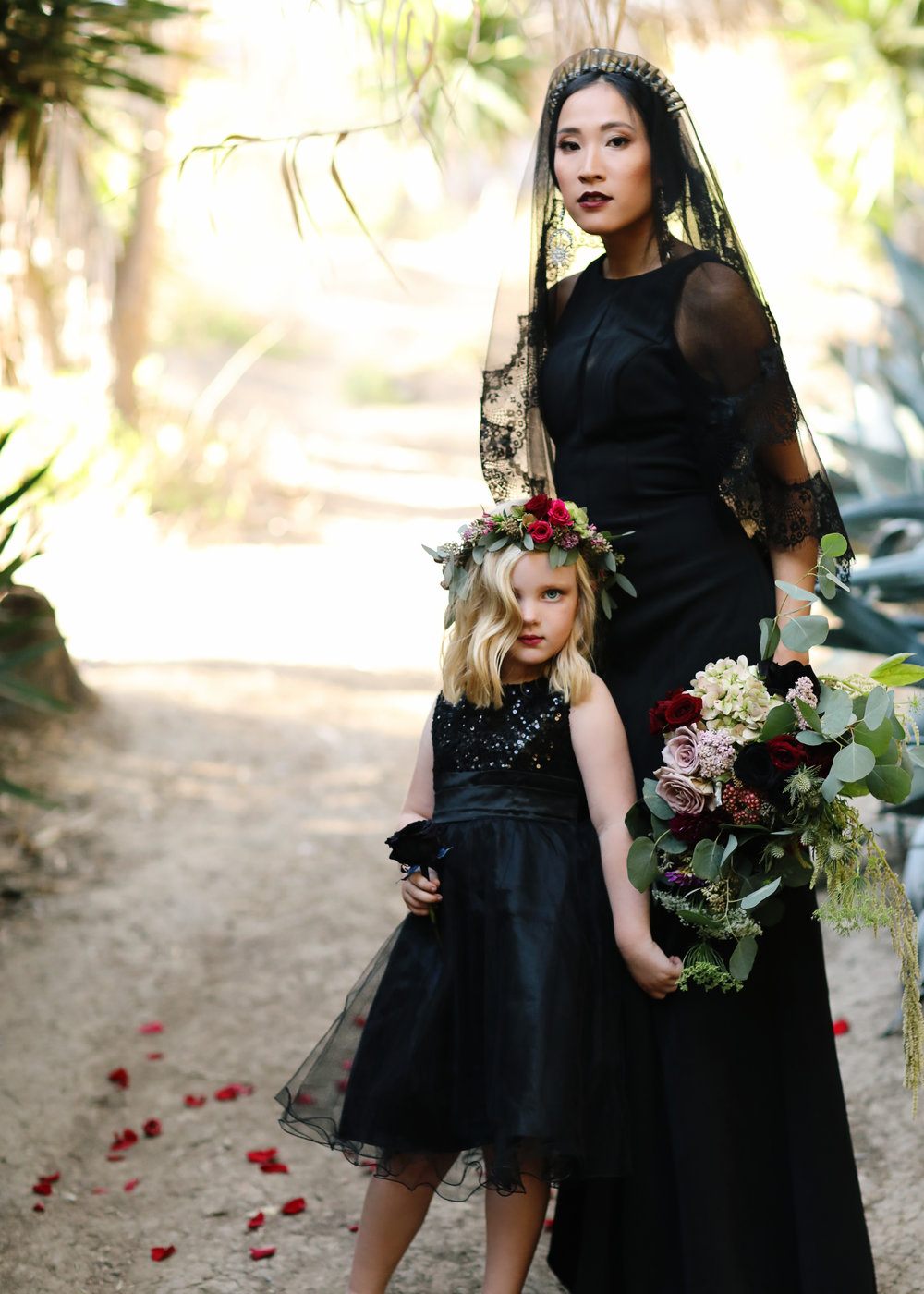Wedding with Black wedding dress and flower girl in a black dress.