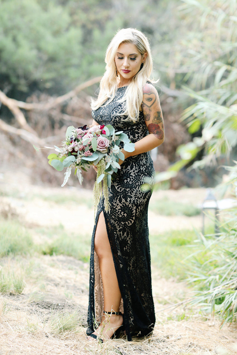 Black wedding dress with a side slit. Blond bride in Orange County.
