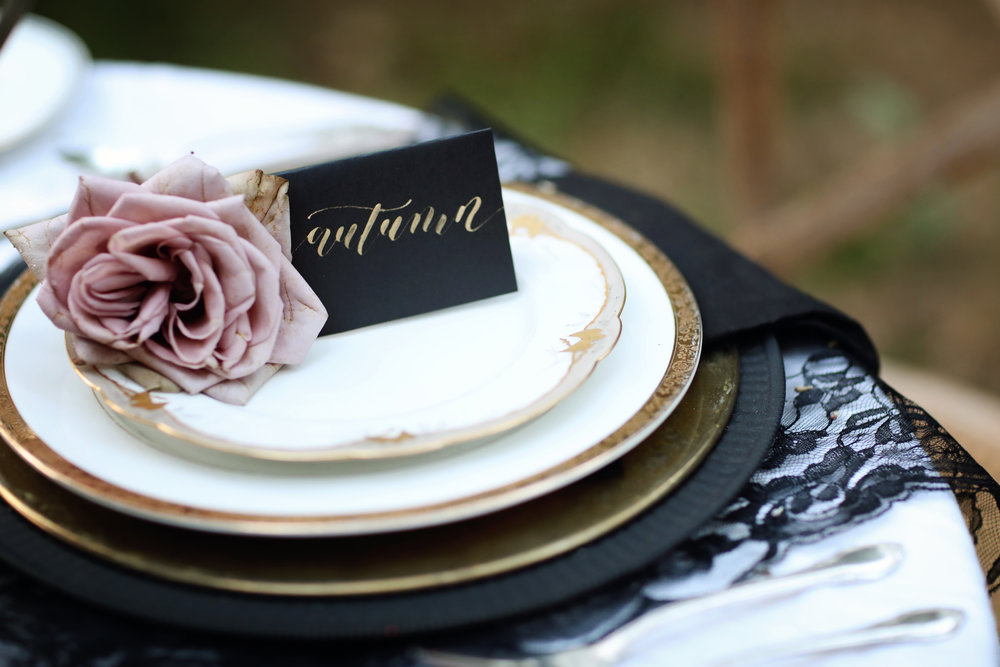 Formal wedding table setting. Hand written place cards.