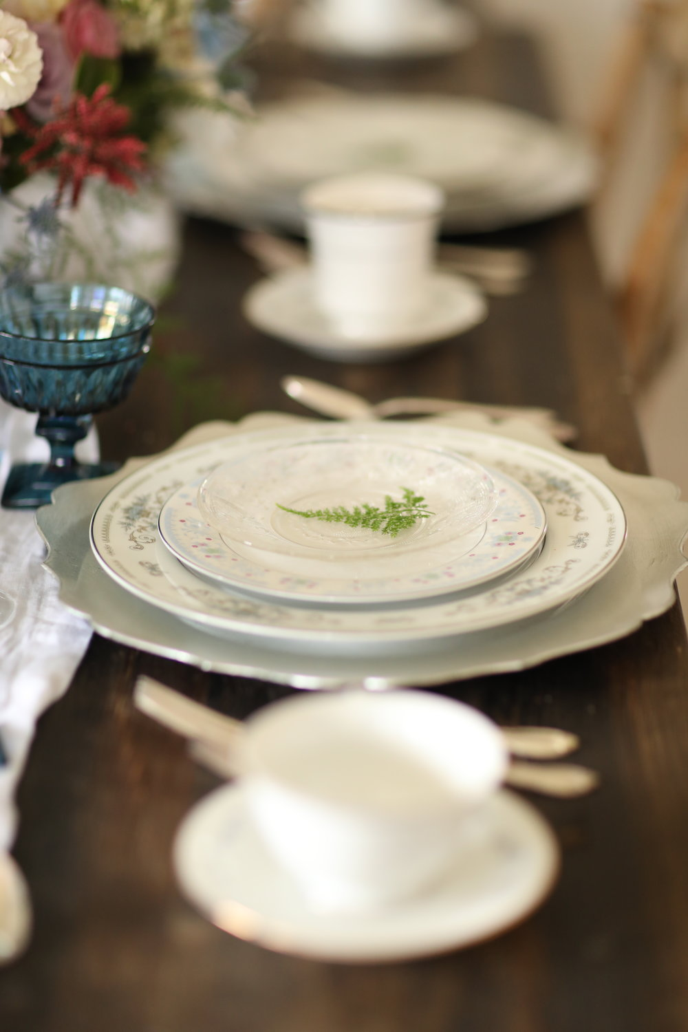 Charger plates used at a bridal party to enhance place settings of china.
