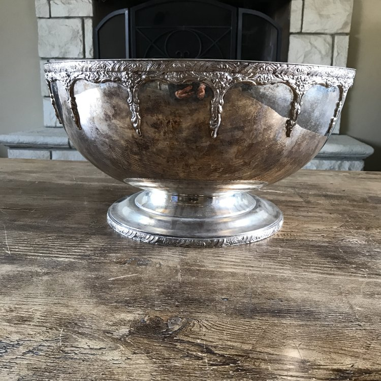 "Large Silver Punch Bowl   Dripping floral rim on a pedestal base. 18"" wide x 9.5"" tall... Holds approximately 4 gallons. Shabby Chic or polished."