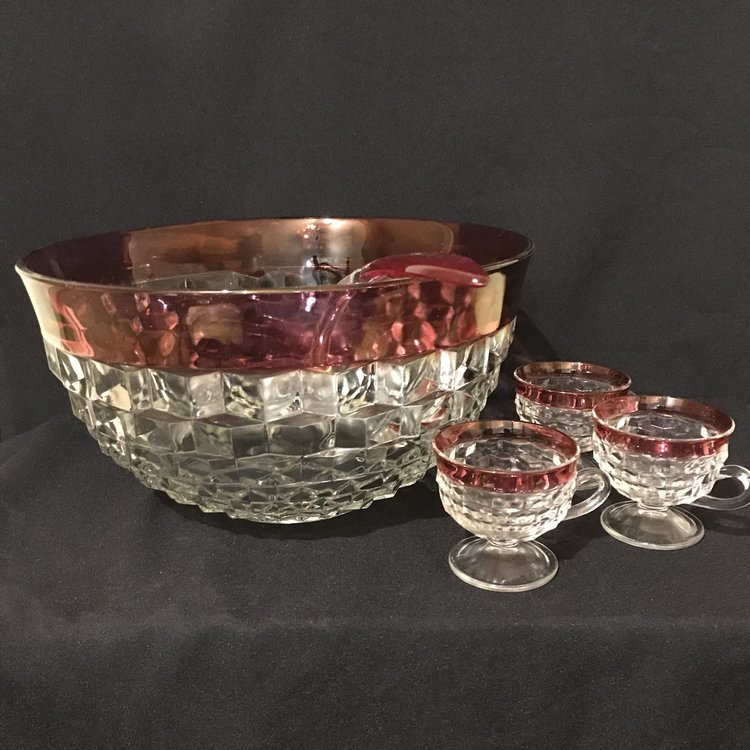 "Ruby Rimmed Punch Bowl   Cut glass with a ruffled cube pattern and a ruby glass rim with ladle. Comes with 12 matching cups with pedestal bases. 13.25"" round x 7"" tall. True Mid-century beauty."