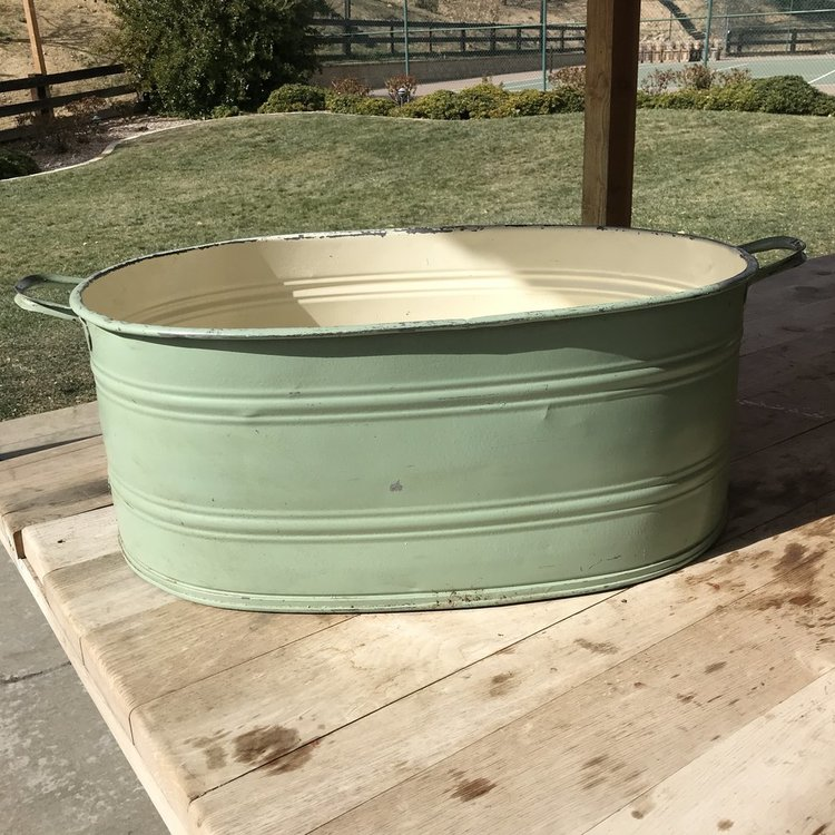 "Green Beverage Tub   Green metal oval beverage tub with cream interior and two handles. 28"" long x 20"" wide x 11"" tall."