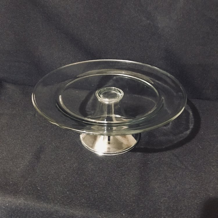 "Clear Pedestal Cake Platter   Clear glass platter with a flared pedestal. 10.5"" round x 4.25"" tall. Simple yet classic. Perfect for cakes and other desserts."