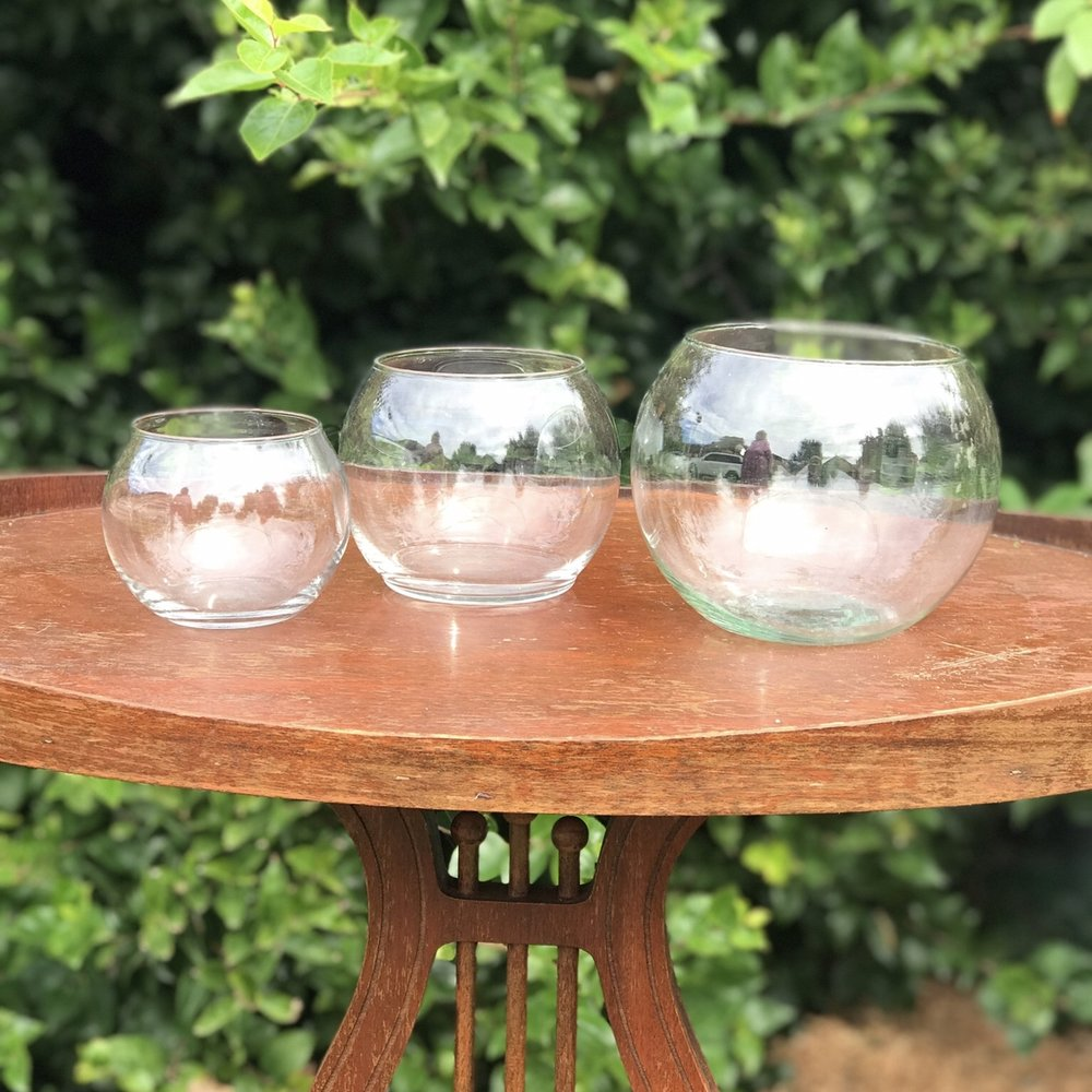 Fish Bowl Containers    Great for floral arrangements or for holding silverware, candy, or any small treat. Also perfect to use as votive candle holders.