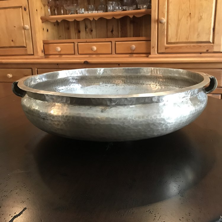 "Boho Silver Bowl   Hammered silver vessel with two handles. 20.5"" x 5"" tall."