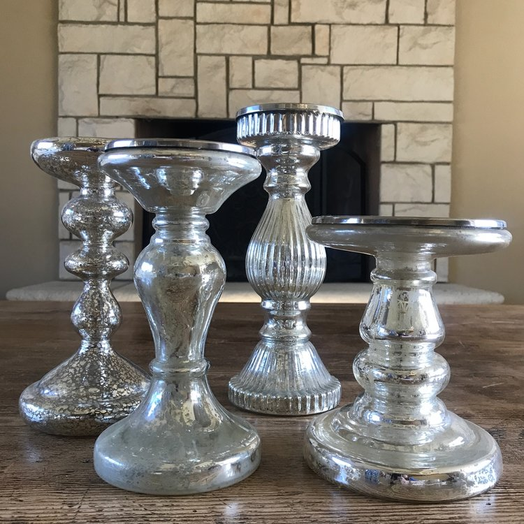 Glass mercury glass candlesticks.