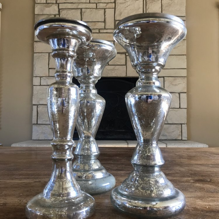 Medium mercury glass candlesticks.