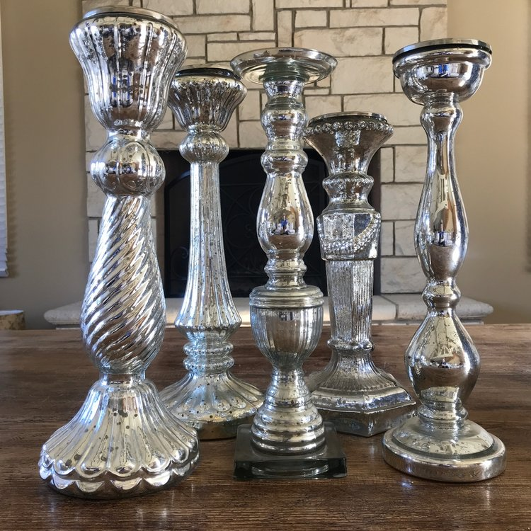 Large mercury glass candlesticks.